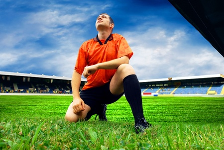 Happiness football player after goal on the field of stadium with blue sky Stock Photo - 8487761