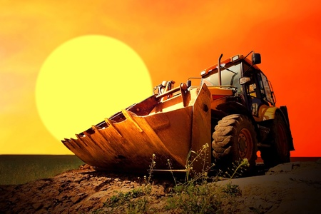 Yellow tractor on golden surise sky Stock Photo - 8487725