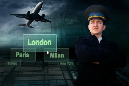Pilot and airports citys on the button and plane photo