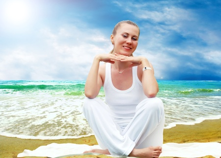 Young beautiful women in white, relaxation on the sunny tropical beach Stock Photo - 8555954