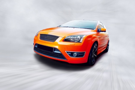 Beautiful orange sport car on road  Stock Photo - 8555989