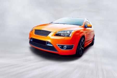 car front view: Beautiful orange sport car on road
