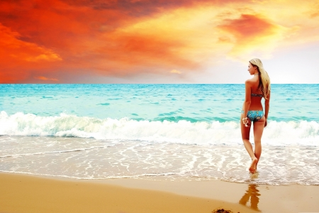 Young beautiful women on the sunny tropical beach in bikini Stock Photo - 8590658