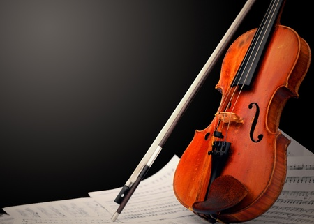 Musical instrument � violin and notes photo