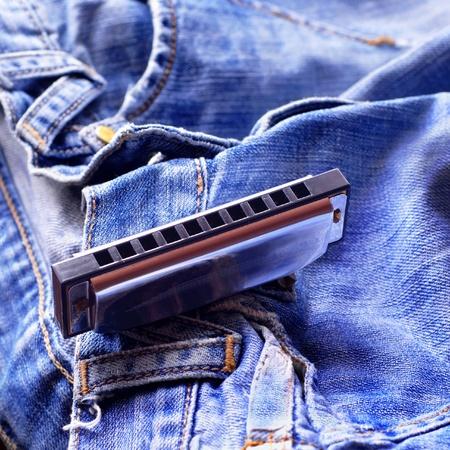 Armónica en los pantalones vaqueros Foto de archivo - 8590747