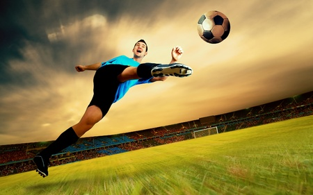 Happiness football player on field of sports competition stadium on sunrise sky Stock Photo - 8615837