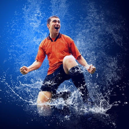 passes: Water drops around football player under water on blue background