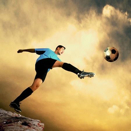 Footballer on the top of mountain photo