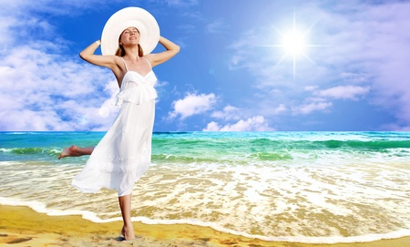 Young beautiful women in the white with pareo on the sunny tropical beach photo