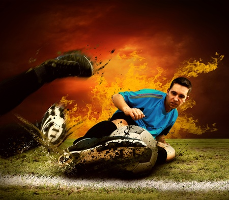 Football player in fires flame on the outdoors field Stock Photo - 8655277