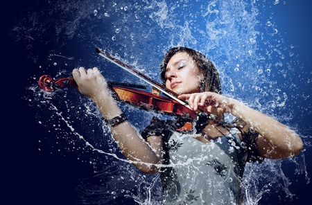 life styles: Musician playing violin under water