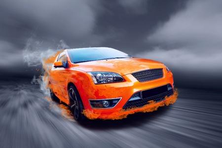 Beautiful orange sport car in fire  photo