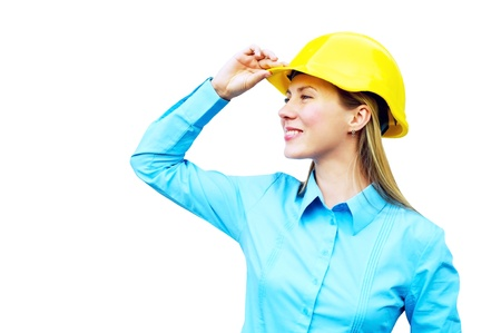 Young architect-woman wearing a protective helmet standing on the building background Stock Photo - 8655775