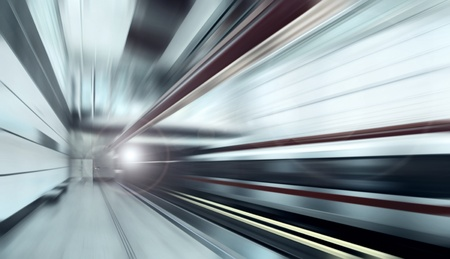 Train on speed in railway station photo