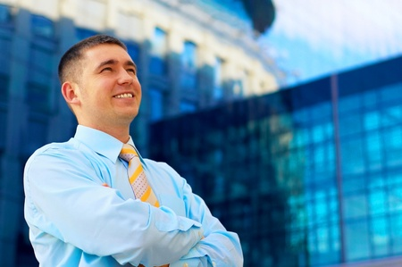 Happiness businessman on the business architecture background  photo