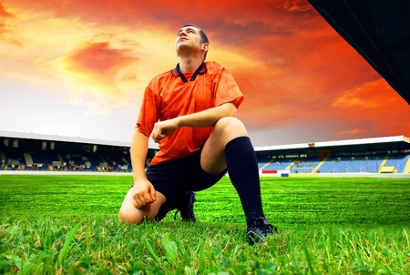 Happiness football player after goal on the field of stadium with blue sky Stock Photo - 8789314