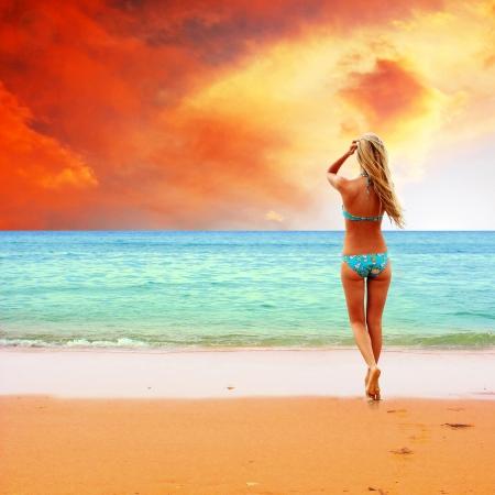 sensational: Young beautiful women on the sunny tropical beach in bikini