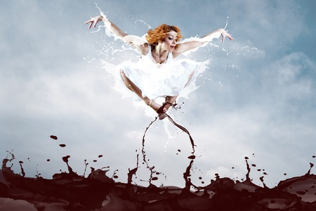 Jump of ballerina with dress of milk Stock Photo - 8996262