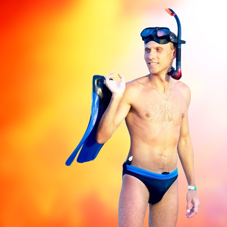 snorkelling: Portrait of happy young man with snorkelling on a sea beach