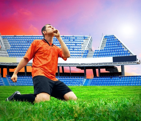 Happiness football player after goal on the field of stadium under sky Stock Photo - 9059604