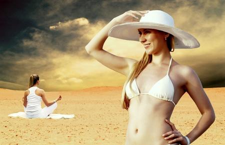 Young beautiful women in whitebikini and hat, relaxation at sunny desert photo