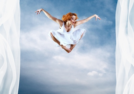 Jump of ballerina with dress of milk Stock Photo - 9123554