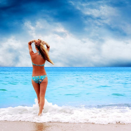 Young beautiful women on the sunny tropical beach in bikini Stock Photo - 9128618
