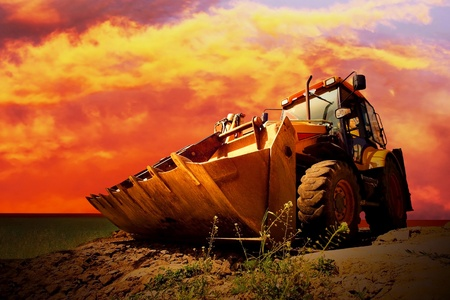 Yellow tractor on golden surise sky Stock Photo - 9166901