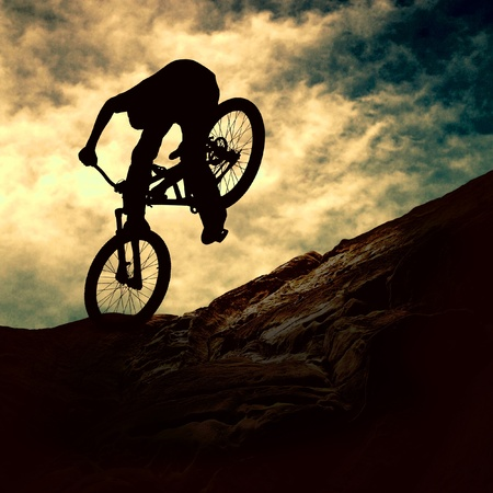 Silhouette of a man on muontain-bike, sunset Stock Photo - 9166906