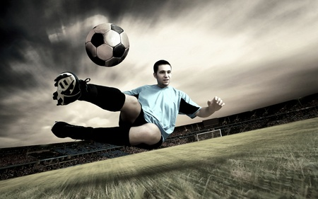 Happiness football player on field of sports competition stadium on sunrise sky Stock Photo - 9199581
