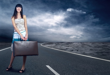 Young woman waiting on the road with her vintage baggage Stock Photo - 9199624