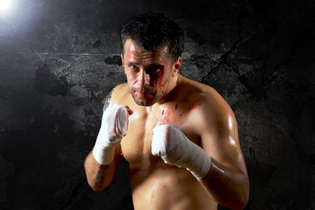 Aggressive boxer with blood on the face Stock Photo - 9199698
