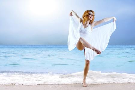 Woman dancer posing on the beach Stock Photo - 9220325