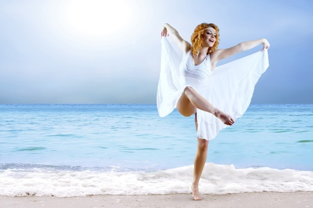 Woman dancer posing on the beach Stock Photo - 9220325