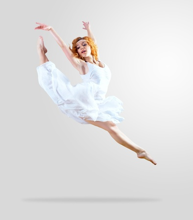 Woman dancer jump posing on background Stock Photo - 9265682