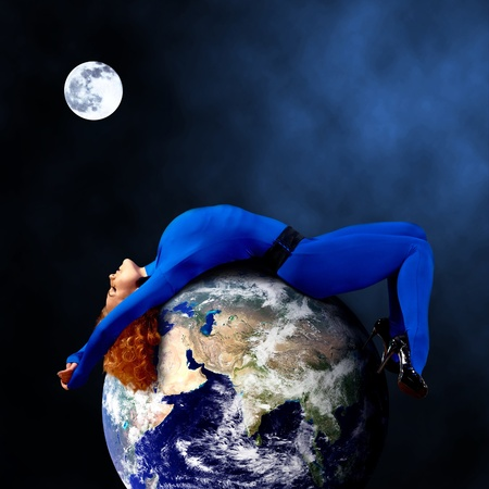 power nap: Woman in blue sleeping on the planet in space. Stock Photo