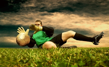 Jump of football goalman on the outdoor field Stock Photo - 9325384
