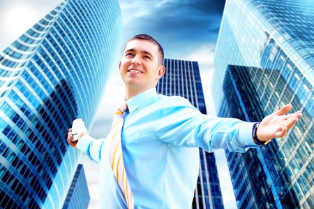 Hapiness Businessman standing on the business background Stock Photo - 9340290