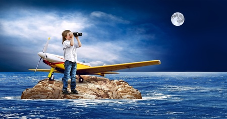 Child with airplane on the island in sea. photo