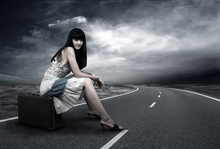 Young woman waiting on the road with her vintage baggage Stock Photo - 9340503