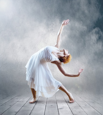 Woman dancer seating posing on background photo