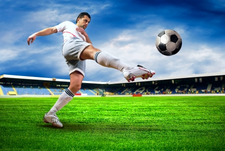Happiness football player after goal on the field of stadium with blue sky Stock Photo - 9477813