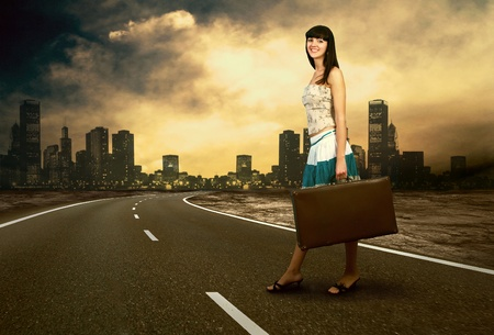Young woman waiting on the road with her vintage baggage Stock Photo - 9648955
