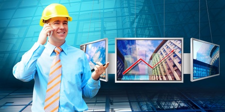 Young architect wearing a protective helmet standing on the building background Stock Photo - 9648964