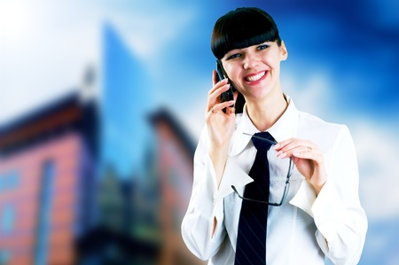Hapiness Businesswoman standing on the business background Stock Photo - 9701757