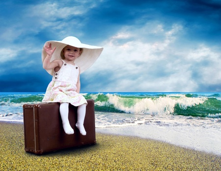 Young child with baggage on the tropical beach Stock Photo - 9701840