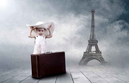 Little girl sitting outdoors on the vintage baggage Stock Photo - 9701839