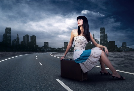 tourists stop: Young woman waiting on the road with her vintage baggage