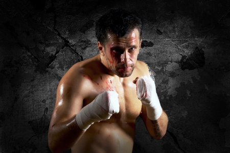 street shot: Aggressive boxer with blood on the face
