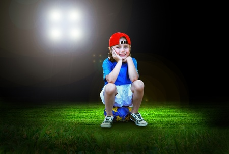 Happiness young boy on the field of stadium with light Stock Photo - 9788873